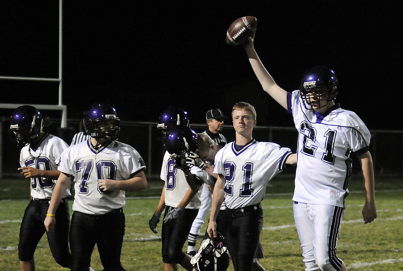 Mountain View High School senior Weston Capps, right, and friends celebrate his touchdown pass during the halftime of Friday night's game against Windsor High School at Patterson Field. Capps is a special needs student at the school who lives with XXYY chromosome disorder, has always wanted to quarterback in a football game and throw a touchdown pass.