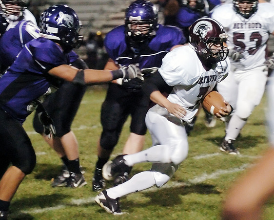Berthoud High School quarterback Zach Ruebesam rushes with the ball in the first quarter of a game against Mountain View on Friday at Patterson Stadium.