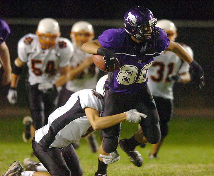 Mountain View #80 tries to escape a tackle by Sterling's #4 during their game Friday.