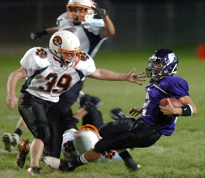 Mountain View's quarterback #2 tries to avoid a sack by Sterling's #39 during their game Friday night.