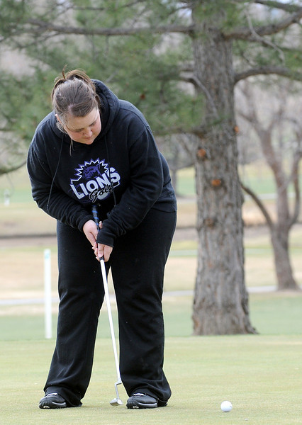 Mountain View High School senior Jessica Shadowen hits a putt on no. 9 during a city golf tournament Wednesday, April 6, 2011 at The Olde Course in Loveland.