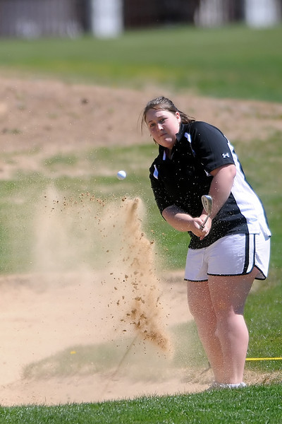 Mountain View High School senior Jessica Shadowen blasts out of the sand and onto the No. 1 green during the R2-J Invitational on Thursday, April 28, 2011 at Mariana Butte Golf Course.