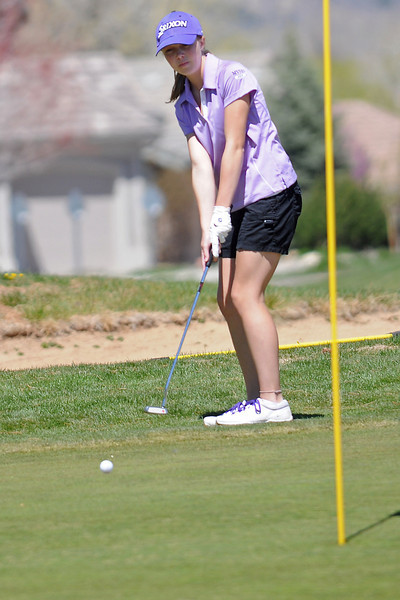 Mountain View High School's Kelsey Greiner watches her putt from the fringe on No. 2 during the R2-J Invitational golf tournament on Thursday, April 28, 2011 at Mariana Butte Golf Course.