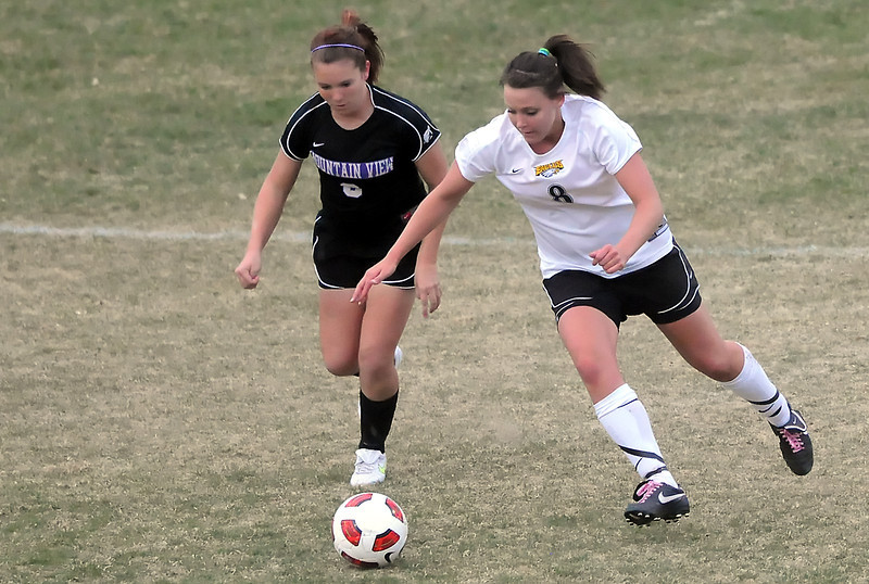 Mountain View High School sophomore Alisha Black, left, and Thompson Valley's Jessica Moran track down the ball in the second half of their match Tuesday, April 12, 2011 at Patterson Stadium.