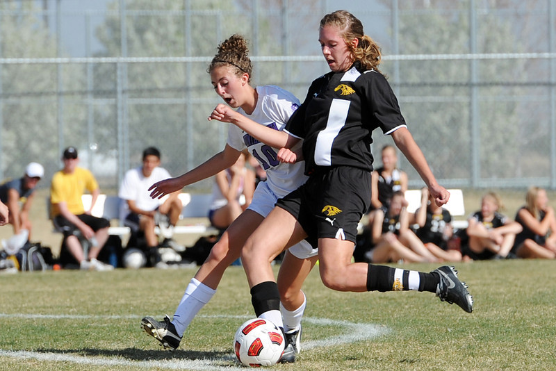 Thompson Valley High School's Paige Chase, right, and Mountain View's MaKenzie Ross battle for control of the ball in the first half of their game Tuesday, April 10, 2012 at MVHS.