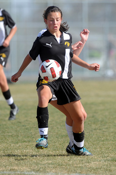 Thompson Valley High School's Ali Artzberger, front, controls the ball in front of Mountain View's MaKenzie Ross in the first half of their game Tuesday, April 10, 2012 at MVHS.