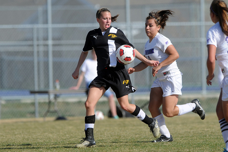 Thompson Valley High School's Allie Davis, left, and Mountain View's Paulina Barraza track down the ball in the first half of their game Tuesday, April 10, 2012 at MVHS.