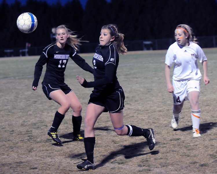 Mountain View High School's Abbey Metzger, left, and Rikelle Berry go against Berthoud's Chloe Murray during their match Thursday, March 24, 2011 at Marr Field in Berthoud. The Mountain Lions won, 4-0.
