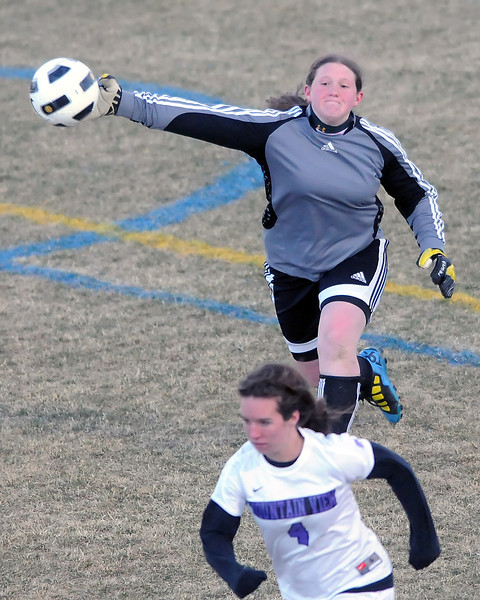 Loveland High School goalie Jordan Rausch puts the ball in play while Mountain View's Rachel Black runs up the field in the second half of their game March 22, 2011 at Patterson Stadium.