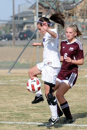 Mountain View High School senior Emily McFeron, left, and Berthoud's McKenna Nauss battle for control of the ball in the first half of their game Wednesday, March 28, 2012 at MVHS.