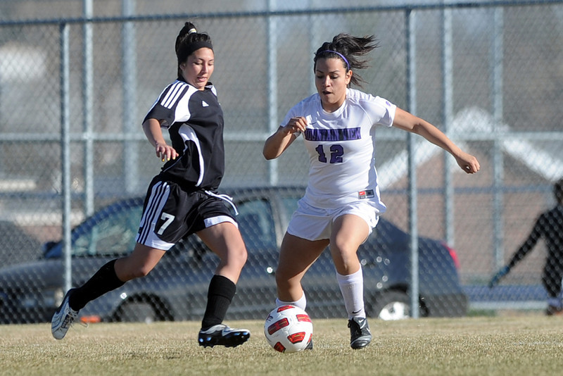 Roosevelt High School's Bre McNeil, left, and Mountain View's Paulina Barraza during their game Wednesday, March 21, 2012 at MVHS.