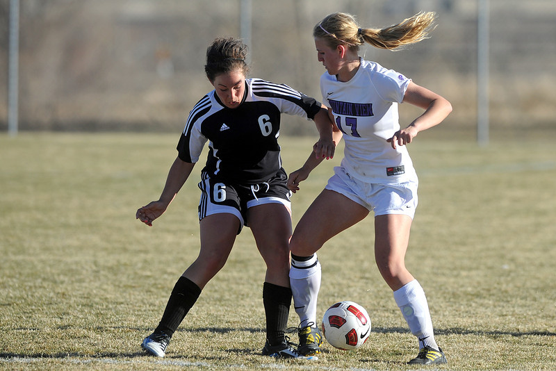 Mountain View High School's Abbey Metzger, right, and Roosevelt's Meghan Pomeroy go after the ball during their game Wednesday, March 21, 2012 at MVHS.