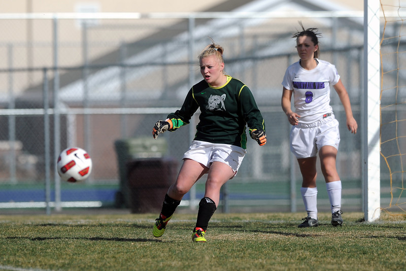 Mountain View High School goalie Shilee Calhoun makes a stop while teammate Kelli Hlushak looks on in the first half of their game against Berthoud on Wednesday, March 28, 2012 at MVHS.
