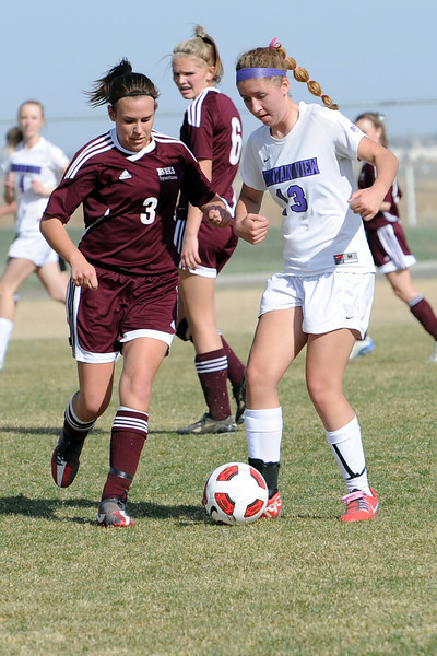 Berthoud High School's Emma Otto, left, and Mountain View's Sara Smith battle for control of the ball in the first half of their game Wednesday, March 28, 2012 at MVHS.