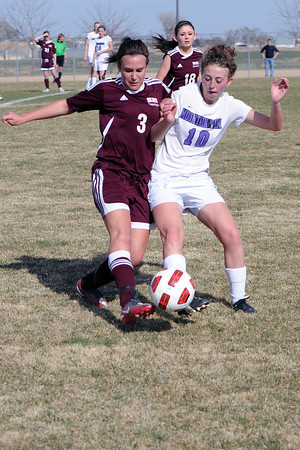 Berthoud High School's Emma Otto, left, and Mountain View's MaKenzie Ross in the first half of their game Wednesday, March 28, 2012 at MVHS.