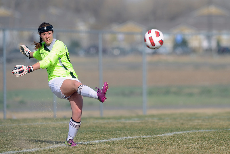 Berthoud High School goalie Mykaela Hughes puts the ball in play during a game against Mountain View on Wednesday, March 28, 2012 at MVHS.