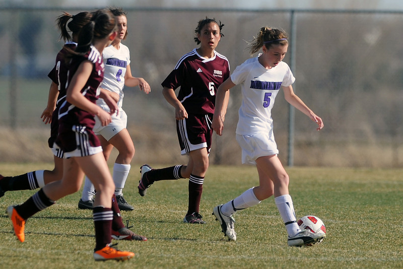 Mountain View High School's Kayla Smith, right, tracks down the ball in the first half of a game against Berthoud on Wednesday, March 28, 2012 at MVHS.