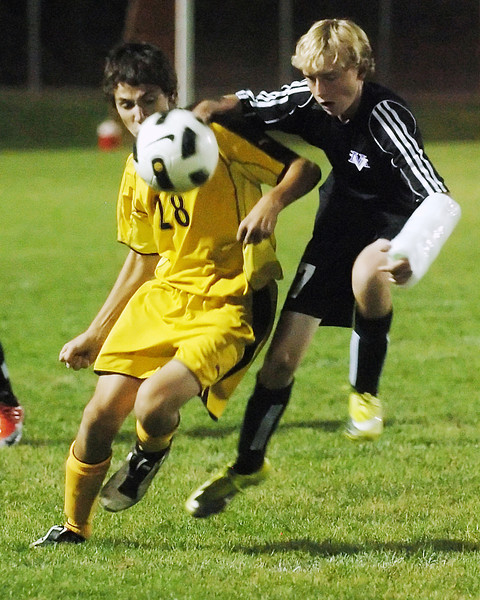 Thompson Valley High School's Quin Scanlon (28) and Mountain View's Blake Christensen battle for control of the ball in the first half of their game on Thursday, Oct. 7, 2010 at Patterson Stadium.