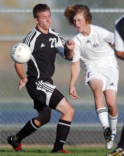 Mountain View High School senior Seth Bratten, right, and Roosevelt's Kody Hutchins track down the ball in the second half of their game on Thursday, Sept. 30, 2010 at MVHS. The Mountain Lions won, 7-0.