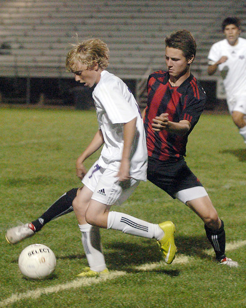 Mountain View High School's Blake Christiansen, left, and Loveland's Sindre Andreassen in the first half of their game on Wednesday, Sept. 15, 2010 at Patterson Stadium. Loveland won, 2-1.