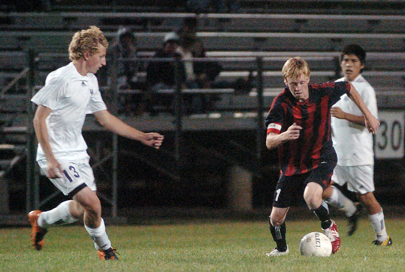 Mountain View High School's Kevin Bell, left, and  Loveland's Dewey Rodgers while  Kevin Aguilar looks on in the second half of their game on Wednesday, Sept. 15, 2010 at Patterson Stadium. Rodgers scored two goals in the Indians' 2-1 win over the Mountain Lions.