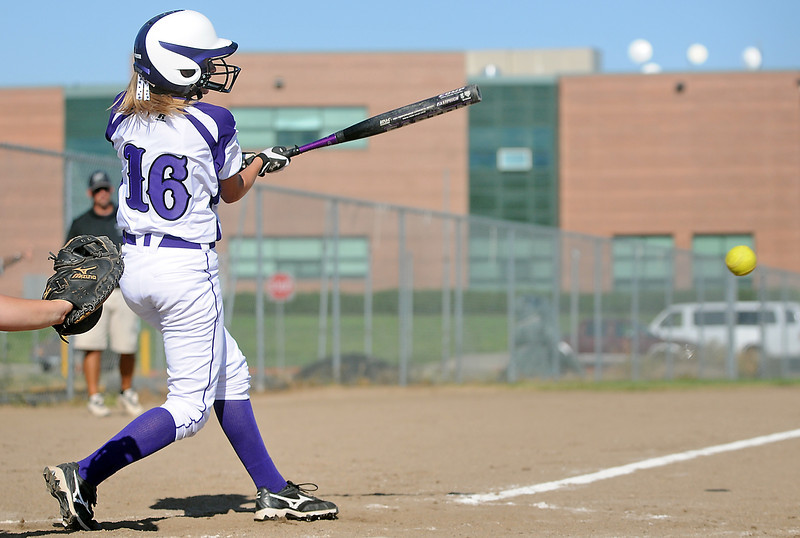Mountain View High School's Stephanie Kerbel hits a single in the bottom of the fourth inning of a game against Loveland on Friday at MVHS. The Mountain Lions won, 3-0.