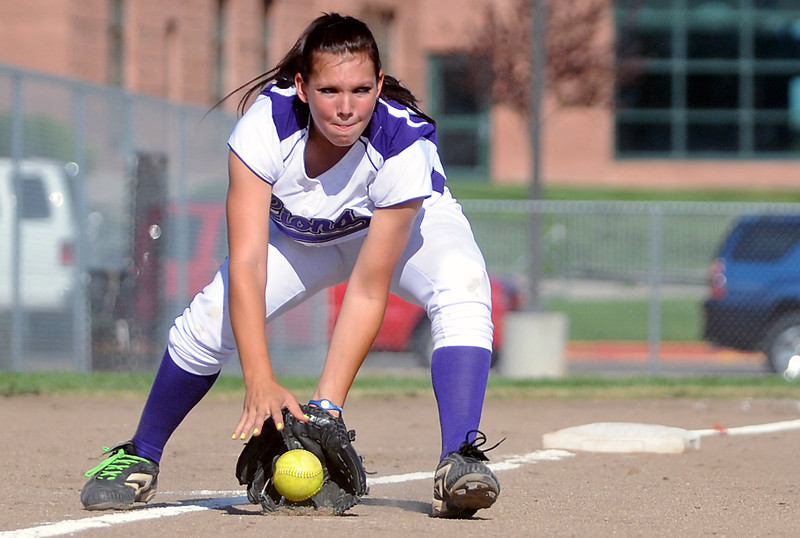 Mountain View High School third baseman #43 fields a ground ball before throwing to first for an out in the top of the fifth inning of a game against Loveland on Friday at MVHS. The Mountain Lions won, 3-0.