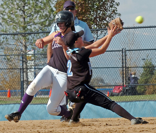 Mountain View's #9 Kellie Eastman runs past Pueblo West's #2 Katie Gonzales on her way to second base during Friday's game at the Aurora Sports Park.