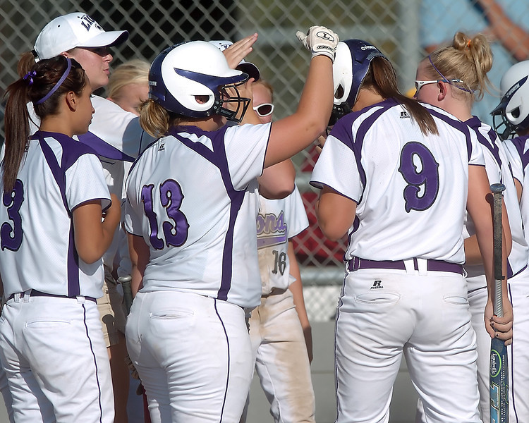 Mountain View High School's Kellie Eastman (9) is congratulated by teammates after hitting a home run in the top of the third inning of a game against Thompson Valley on Thursday, Sept. 16, 2010 at Centennial Field.
