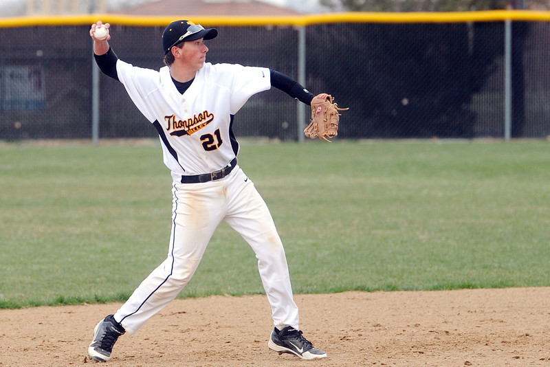 Thompson Valley High School shortstop Brad Soucek throws to first base after fielding a ground ball during a game against Mountain View on Thursday, April 25, 2013 at Constantz Field.