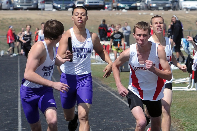 Mountain View High School's Ryan Vomaka, left, and Jose Salgado and Loveland's Dylan Dunhau and Patrick O'Brien compete in the 3200-meter relay during the R2J Invitational meet on Wednesday, April 24, 2013 at LHS.