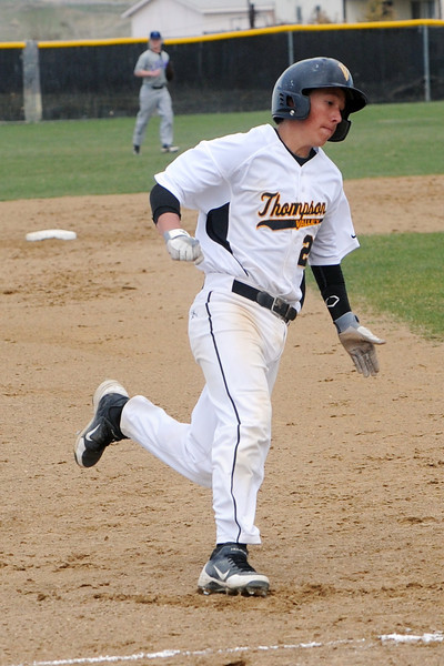 Thompson Valley High School junior Brad Soucek gets ready to step on third base on his way to scoring a run in the bottom of the second inning of a game against Mountain View on Thursday, April 26, 2013 at Constantz Field.