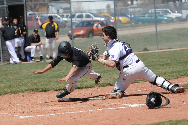Mountain View High School catcher Dakota Shea-Shelley tags out Thompson Valley's Drew Meintzer after a rundown in the top of the fourth inning of their game Saturday, April 27, 2013 at Brock Field.