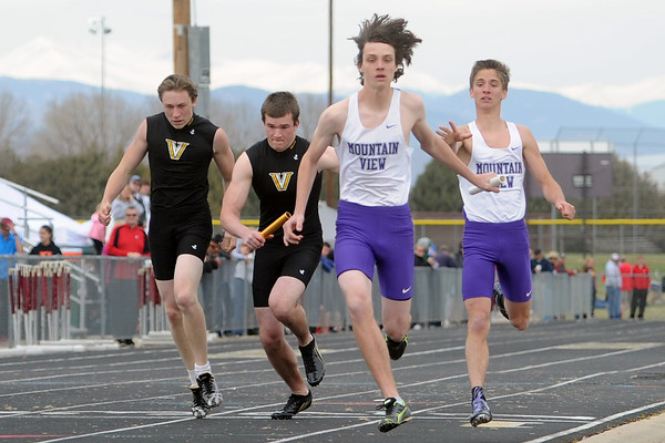 Mountain View High School junior Lorenzo Rigatti, right, passes the baton to freshman Brett Tollin while competing in the 800-meter relay during the Max Marr Invitational on Saturday, April 13, 2013 at Berthoud High School.