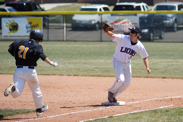 Mountain View High School's Hunter Porterfield steps on first base to force out Thompson Valley batter Brad Soucek in the top of the third inning of their game Saturday, April 27, 2013 at Brock Field.