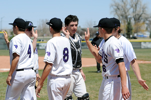 Mountain View High School baseball players congratulate each other after defeating Thompson Valley, 3-1, on Saturday, April 27, 2013 at Brock Field.