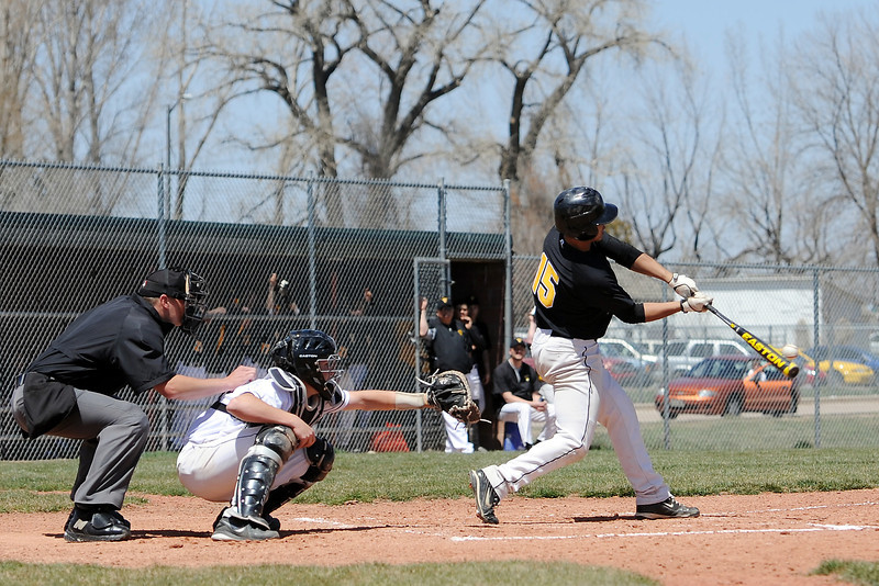 Thompson Valley High School's Trevon Yep hits a single in front of Mountain View catcher Dakotah Shea-Shelley in the top of the fourth inning of their game Saturday, April 27, 2013 at Brock Field.