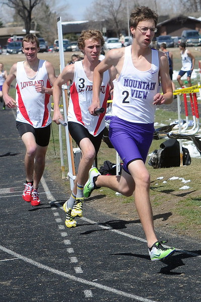 Mountain View High School senior Dixon Cooney, right, runs the anchor leg in a heat of the 3200-meter relay during the R2J Invitational meet on Wednesday, April 24, 2013 at Loveland High School.