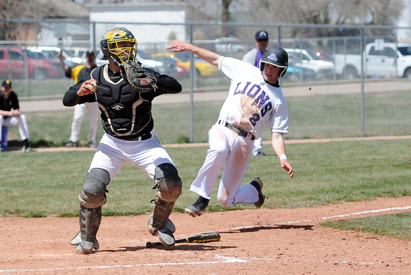 Thompson Valley High School catcher DJ Grine steps on home plate to force out Mountain View baserunner Max Moree in the bottom of the sixth inning of their game Saturday, April 27, 2013 at Brock Field.