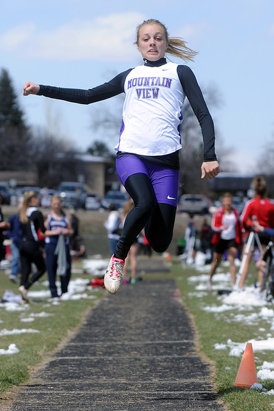 Mountain View High School sophomore Baylee Butcher competes in the long jump during the R2J Invitational meet on Wednesday, April 24, 2013 at Loveland High School.