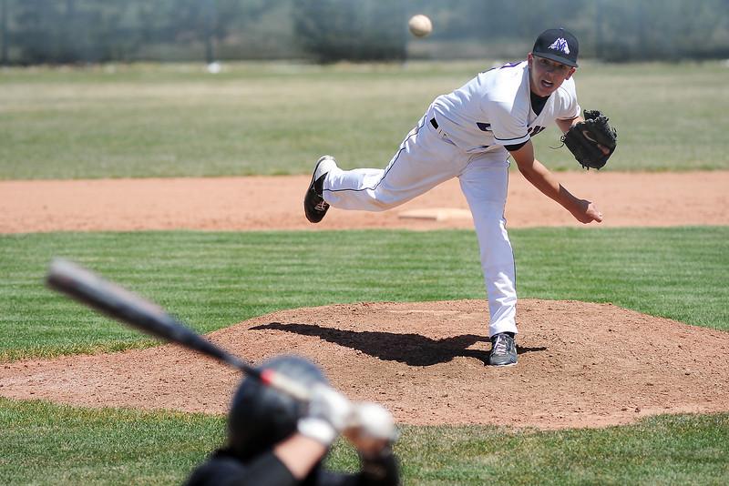 Mountain View High School's Adam Baumann throws a pitch in the top of the third inning of a game against Thompson Valley on Saturday, April 27, 2013 at Brock Field.