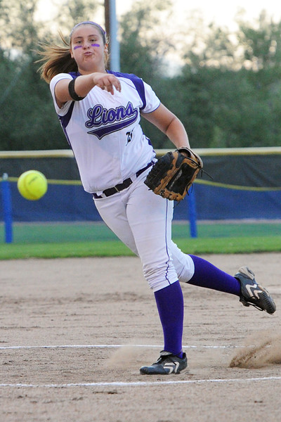 Mountain View High School junior Mia Trujillo throws a pitch in the bottom of the second inning of a game against Thompson Valley on Thursday, Aug. 23, 2012 at Centennial Park.