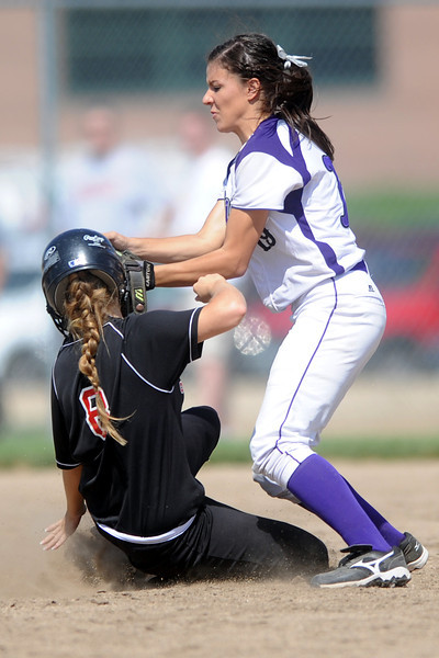 Mountain View High School second baseman Andrea Baumann tags out Loveland baserunner Addie Coldiron during their game on Saturday, Aug. 25, 2012 at MVHS.