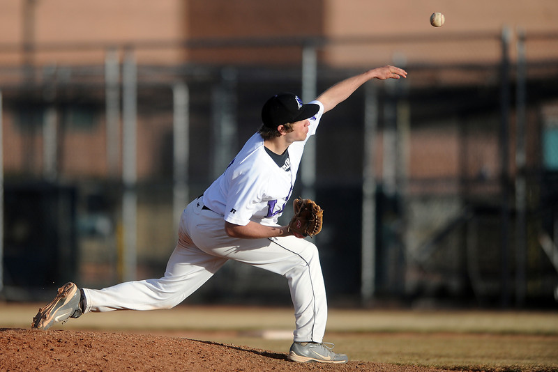 Mountain View High School junior Hunter Porterfield throws a pitch during the sixth inning of a game played against Greeley West High School, Monday evening at MVHS.