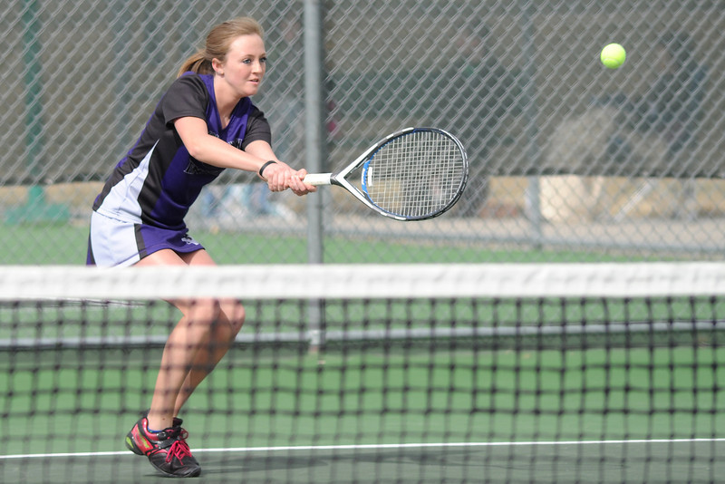 Mountain View High School senior Bri Dupre hits a backhand during her No. 3 singles match against Loveland's Kim Weissmann on Wednesday, March 20, 2013 at LHS.