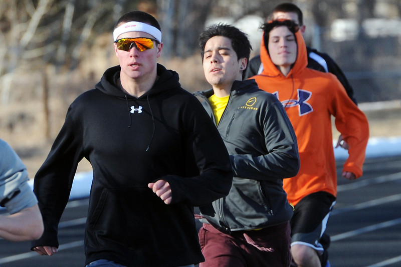 Mountain View High School senior Tyler Kress, left, trains with his track teammates Tuesday, March 1, 2013 during practice at the school.