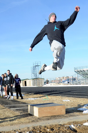 Mountain View High School senior Josh Sandin flies through the air while practicing long jump with teammates on Tuesday, March 5, 2013 at the school. Sandin holds the school record in long jump at 22-feet, 9-inches and placed second at the state championships last year.