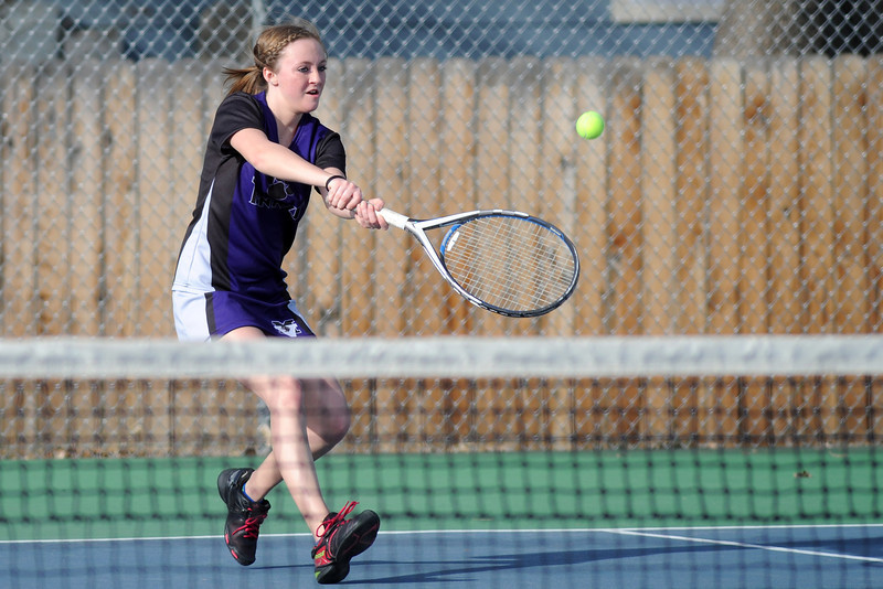 Mountain View High School's Bri Dupre hits a backhand during her No. 3 singles match against Thompson Valley's Miranda Sheets on Thursday, March 14, 2013 at TVHS.
