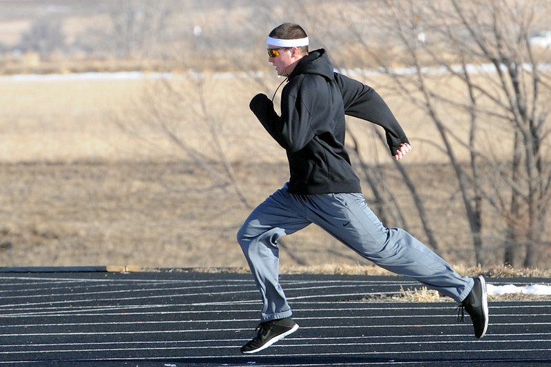 Mountain View High School senior Tyler Kress trains during track practice Tuesday, March 1, 2013 outside the school.