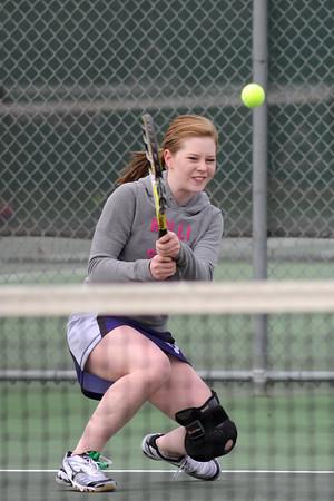 Mountain View High School's Kelci Mueller hits a backhand during her No. 2 singles match against Loveland's Sarah Klinkenbeard on Wednesday, March 20, 2013 at LHS.